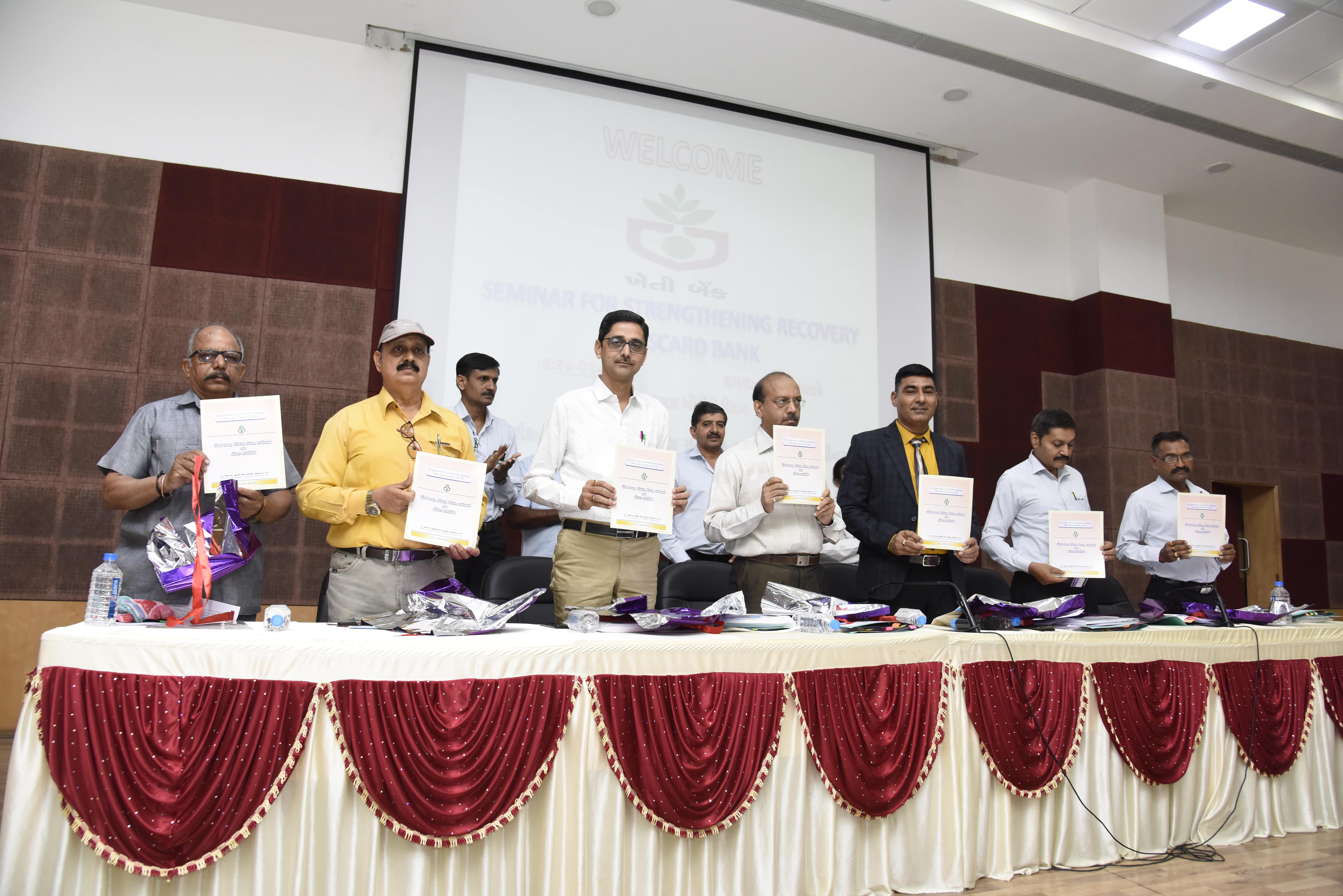 Honble Joint Registrar Shri U.M.Vasanawala, General Manager of the Bank Shri V.M Chaudhary releasing the Bank's information booklet at the Recovery Seminar.